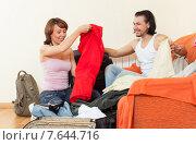 Купить «couple sitting on a striped couch and packs a suitcase at home», фото № 7644716, снято 3 июня 2013 г. (c) Яков Филимонов / Фотобанк Лори