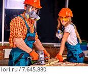 Купить «People in builder helmet .», фото № 7645880, снято 9 ноября 2013 г. (c) Gennadiy Poznyakov / Фотобанк Лори