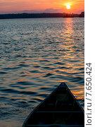 Купить «Boat in a lake at sunset, Lake of The Woods, Ontario, Canada», фото № 7650424, снято 15 июля 2013 г. (c) Ingram Publishing / Фотобанк Лори