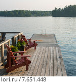 Купить «Adirondack chairs on a dock at the lakeside, Lake of The Woods, Ontario, Canada», фото № 7651448, снято 30 июня 2013 г. (c) Ingram Publishing / Фотобанк Лори