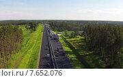 Купить «Вид с воздуха на ремонт дорог», видеоролик № 7652076, снято 7 июля 2015 г. (c) Discovod / Фотобанк Лори