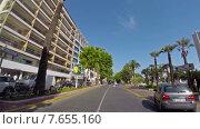 Купить «Вид из автомобиля на улицу вдоль побережья в Каннах, Франция», видеоролик № 7655160, снято 22 июня 2014 г. (c) Алексас Кведорас / Фотобанк Лори