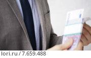 Купить «close up of businessman taking money bribe», видеоролик № 7659488, снято 12 апреля 2015 г. (c) Syda Productions / Фотобанк Лори