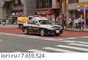 Купить «Полицейская патрульная машина на улице Токио, Япония», эксклюзивное фото № 7659524, снято 25 мая 2015 г. (c) Иван Марчук / Фотобанк Лори