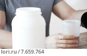 Купить «close up of man with protein shake bottle and jar», видеоролик № 7659764, снято 16 мая 2015 г. (c) Syda Productions / Фотобанк Лори
