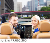 Купить «happy couple driving in cabriolet car over city», фото № 7666360, снято 22 января 2015 г. (c) Syda Productions / Фотобанк Лори