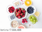 Купить «close up of fruits and berries in bowl on table», фото № 7666488, снято 29 апреля 2015 г. (c) Syda Productions / Фотобанк Лори