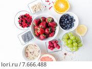 Купить «close up of fruits and berries in bowl on table», фото № 7666488, снято 29 апреля 2015 г. (c) Syda Productions / Фотобанк Лори