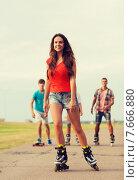 Купить «group of smiling teenagers with roller-skates», фото № 7666880, снято 10 августа 2014 г. (c) Syda Productions / Фотобанк Лори