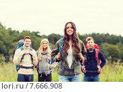 Купить «group of smiling friends with backpacks hiking», фото № 7666908, снято 31 августа 2014 г. (c) Syda Productions / Фотобанк Лори