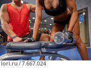 Купить «young couple with dumbbell flexing muscles in gym», фото № 7667024, снято 19 апреля 2015 г. (c) Syda Productions / Фотобанк Лори