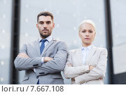 Купить «serious businessmen standing over office building», фото № 7667108, снято 19 августа 2014 г. (c) Syda Productions / Фотобанк Лори