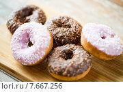 Купить «close up of glazed donuts pile on table», фото № 7667256, снято 21 мая 2015 г. (c) Syda Productions / Фотобанк Лори