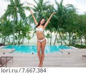 happy young woman in white bikini swimsuit dancing. Стоковое фото, фотограф Syda Productions / Фотобанк Лори