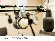 Купить «headphones at recording studio or radio station», фото № 7667656, снято 8 апреля 2015 г. (c) Syda Productions / Фотобанк Лори