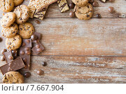 Купить «close up of candies, chocolate, muesli and cookies», фото № 7667904, снято 22 мая 2015 г. (c) Syda Productions / Фотобанк Лори