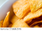 Купить «close up of corn crisps or nachos in bowl», фото № 7668516, снято 21 мая 2015 г. (c) Syda Productions / Фотобанк Лори