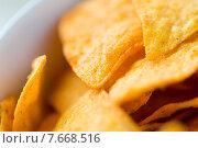 Купить «close up of corn crisps or nachos in bowl», фото № 7668516, снято 21 мая 2015 г. (c) Syda Productions / Фотобанк Лори