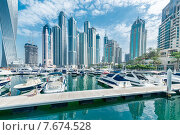Купить «Dubai - AUGUST 9, 2014: Dubai Marina district on August 9 in UAE», фото № 7674528, снято 9 августа 2014 г. (c) Elnur / Фотобанк Лори