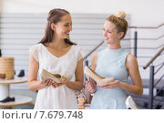 Купить «Two happy women holding heel shoes», фото № 7679748, снято 3 марта 2015 г. (c) Wavebreak Media / Фотобанк Лори