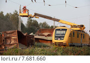 Купить «Hosena, Germany, Eisenbahnunglueck in Brandenburg, workers remove the overhead line», фото № 7681660, снято 27 июля 2012 г. (c) Caro Photoagency / Фотобанк Лори