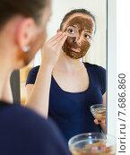 Купить «Girl applying mask for facial skin care», фото № 7686860, снято 21 августа 2018 г. (c) Яков Филимонов / Фотобанк Лори