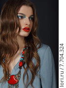 Купить «Young Woman with Bright Makeup and Necklace», фото № 7704324, снято 17 августа 2018 г. (c) PantherMedia / Фотобанк Лори