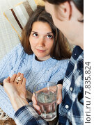 Купить «Guy giving tablets to unwell girlfriend», фото № 7835824, снято 28 марта 2014 г. (c) Яков Филимонов / Фотобанк Лори