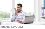 Купить «businessman with laptop calling on smartphone», видеоролик № 8077352, снято 9 июля 2015 г. (c) Syda Productions / Фотобанк Лори