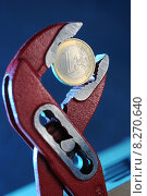 Купить «1 Euro coin in an adjustable wrench», фото № 8270640, снято 18 мая 2010 г. (c) Caro Photoagency / Фотобанк Лори