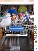 Купить «open dishwasher with clean dishes in kitchen», фото № 8336560, снято 24 августа 2019 г. (c) PantherMedia / Фотобанк Лори