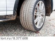 Купить «close up of dirty car wheel on ground», фото № 8377608, снято 28 марта 2015 г. (c) Syda Productions / Фотобанк Лори