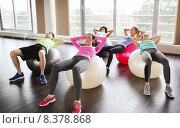 Купить «happy people flexing abdominal muscles on fitball», фото № 8378868, снято 5 апреля 2015 г. (c) Syda Productions / Фотобанк Лори