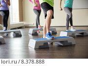 Купить «group of people flexing legs on step platforms», фото № 8378888, снято 5 апреля 2015 г. (c) Syda Productions / Фотобанк Лори