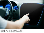 Купить «male hand pointing finger to monitor on car panel», фото № 8393028, снято 26 июня 2013 г. (c) Syda Productions / Фотобанк Лори
