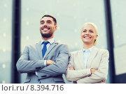 Купить «smiling businessmen standing over office building», фото № 8394716, снято 19 августа 2014 г. (c) Syda Productions / Фотобанк Лори