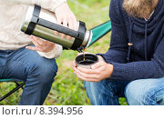 Купить «close up of hikers pouring tea from thermos to cup», фото № 8394956, снято 31 августа 2014 г. (c) Syda Productions / Фотобанк Лори