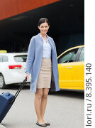 Купить «smiling young woman with travel bag over taxi», фото № 8395140, снято 10 мая 2015 г. (c) Syda Productions / Фотобанк Лори