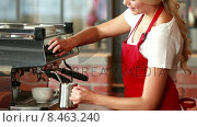 Купить «Smiling barista steaming milk at the coffee machine», видеоролик № 8463240, снято 16 сентября 2019 г. (c) Wavebreak Media / Фотобанк Лори