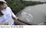 Купить «Девушка с сыном проходят по узкому мосту над бурной горной рекой», эксклюзивный видеоролик № 8476860, снято 26 июля 2015 г. (c) Алексей Бок / Фотобанк Лори