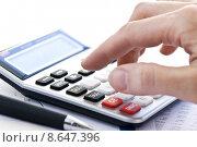 Купить «Tax calculator and pen», фото № 8647396, снято 6 октября 2018 г. (c) PantherMedia / Фотобанк Лори