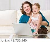 Купить «Grandmother and granddaughter using laptop», фото № 8735540, снято 19 марта 2019 г. (c) PantherMedia / Фотобанк Лори