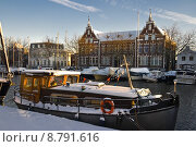 Купить «Old buildings and old ship with snow on sunny winterday», фото № 8791616, снято 11 декабря 2017 г. (c) PantherMedia / Фотобанк Лори