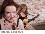 Купить «Female musicians», фото № 8898024, снято 25 апреля 2019 г. (c) PantherMedia / Фотобанк Лори