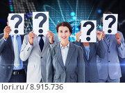 Купить «Composite image of business colleagues hiding their face with question mark sign», фото № 8915736, снято 18 октября 2018 г. (c) Wavebreak Media / Фотобанк Лори