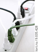 Wires plugged into power bar. Стоковое фото, фотограф Elena Elisseeva / PantherMedia / Фотобанк Лори