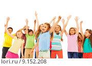 Купить «Счастливые дети с поднятыми руками на белом фоне», фото № 9152208, снято 30 мая 2015 г. (c) Сергей Новиков / Фотобанк Лори