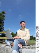Купить «Man using laptop computer on a pontoon», фото № 9200608, снято 20 января 2019 г. (c) PantherMedia / Фотобанк Лори