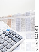 Купить «Calculator on top of newspaper with $ figurer amounts», фото № 9229612, снято 23 июля 2019 г. (c) PantherMedia / Фотобанк Лори