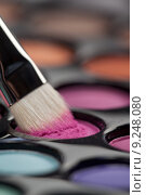 Купить «eyeshadow set with makeup brush picking up color», фото № 9248080, снято 23 июля 2018 г. (c) PantherMedia / Фотобанк Лори